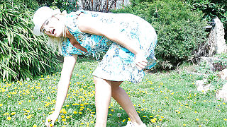 Naughty blonde housewife playing in her garden