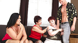Three naughty mature ladies sharing one hard cock