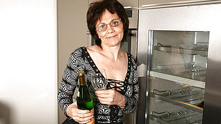 Horny mature slut loves masturbating while drinking champagne