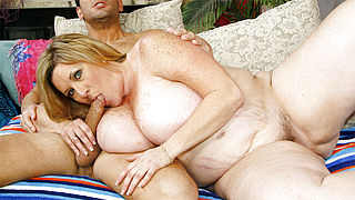 Blonde mature sucks a cock