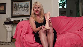 Aroused lady uses monster dildo on her mature pussy