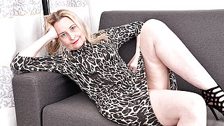 Horny British housewife getting wet and wild on her couch