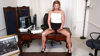 Naughty American MILF playing with her pussy at the office